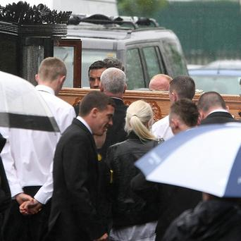 The coffin of Daniel McAnaspie arrives at the Church of the Annunciation in Finglas, west Dublin, ahead of his funeral.