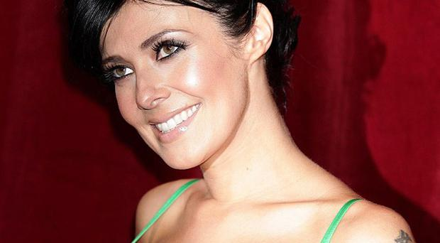 Coronation Street star Kym Marsh has postponed plans to wed Jamie Lomas due to work commitments