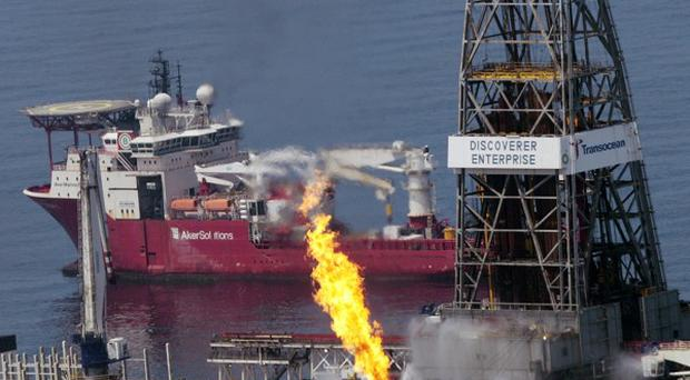 The Transocean Discoverer Enterprise burns off some natural gas as it takes on oil from the broken BP wellhead. (AP)