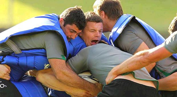 Brian O'Driscoll and Rob Kearney in the action during yesterday's training