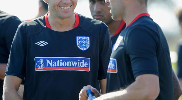 RUSTENBURG, SOUTH AFRICA - JUNE 08: Steven Gerrard shares a joke with Matthew Upson during the England training session at the Royal Bafokeng Sports Campus on June 8, 2010 in Rustenburg, South Africa. (Photo by Michael Regan/Getty Images)