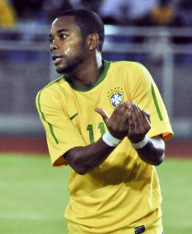 <b>Robinho (Brazil)</b><br/> Yes, the very same Robinho who could be found moping around Eastlands, trying to figure out how he hadn't signed for Chelsea. Robinho's time in the Premier League was not good, and in the end he got his wish and was sent out on loan to Santos in Brazil. But although he will be remembered as one of the worst signings in Premier League history - he had moments that showed just why Manchester City paid over £30m for his services. And for his country, he tends to show those magic moments on a consistent basis.