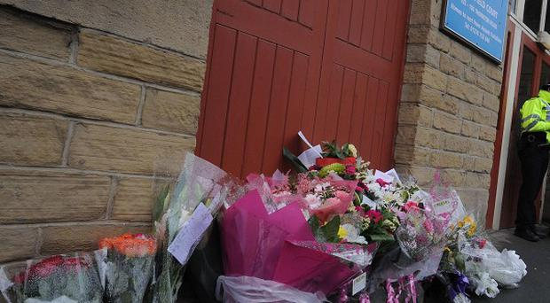 Floral tributes are left outside the apartment of Stephen Griffiths, the Bradford man facing charges of the murder of three sex workers.