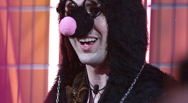Mario, dressed as a mole, enters the Big Brother house