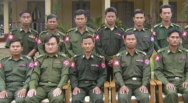 Burma defector Sai Thein Win, second from left in front row, is photographed with others. (AP)