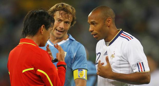 Thierry Henry of France appeals to referee Yuichi Nishimura for a penalty