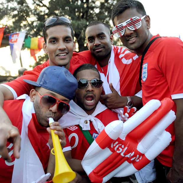 England supporters gather outside the Royal Bafokeng Stadium in Rustenburg