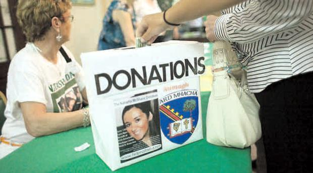 Dollars flowing into a donations box