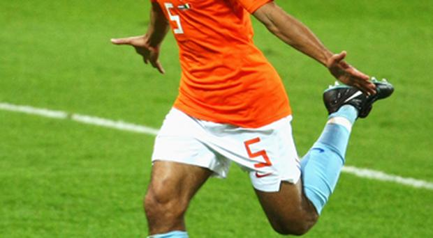 Giovanni van Bronckhorst of Netherlands celebrates scoring