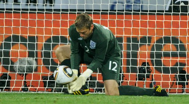 Robert Green of England misjudges the ball and lets in a goal during the 2010 FIFA World Cup South Africa Group C match between England and USA at the Royal Bafokeng Stadium on June 12, 2010
