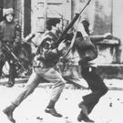 30th January 1972: An armed soldier and a protestor on Bloody Sunday when British Paratroopers shot dead 13 civilians on a civil rights march.