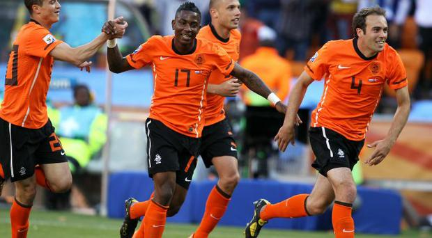 Eljero Elia of the Netherlands celebrates with team mates after his shot hit the post and Dirk Kuyt scores from the rebound during the 2010 FIFA World Cup Group E match between Netherlands and Denmark