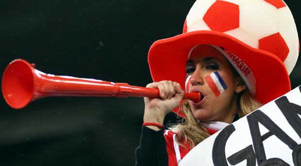 A Paraguay fan blows a vuvuzela as she enjoys the atmosphere prior to the 2010 FIFA World Cup South Africa Group F match between Italy and Paraguay
