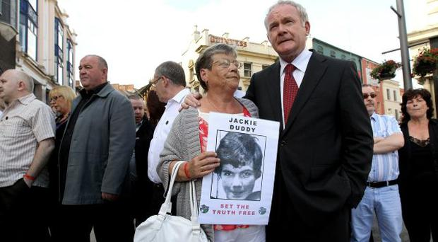 A relative of Bloody Sunday victim Jackie Duddy is comforted by Martin McGuinness as she marches from the Bogside area of Londonderry to the Guildhall to gain a preview of the Saville Report on June 15, 2010
