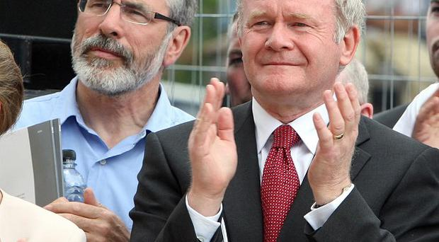 Deputy First Minister Martin McGuinness (right) with Sinn Fein President Gerry Adams, applaud the Saville Inquiry report