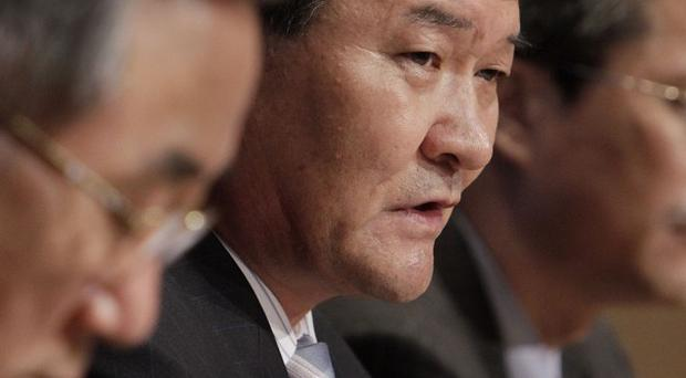 North Korea's UN Ambassador Sin Son Ho, centre, flanked by members of his delegation, addresses a news conference at the United Nations