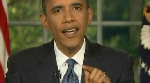 US President Barack Obama speaks during a televised address from the Oval Office in the White House in Washington