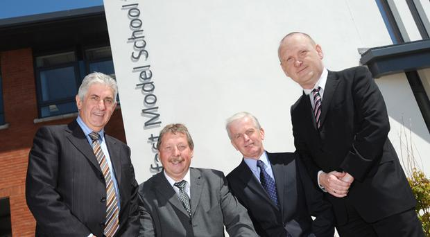 Finance Minister Sammy Wilson today highlighted the benefits of investment in our local schools during his visit to the Belfast Boys' Model and the Model School for Girls. Photographed with the minister are Robert McAlister Directot of Building Contracts Farrans, Johnny Graham Headmaster Model School for Girls and Architect Martin Hare McAdam Design