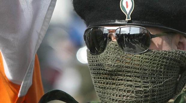 A masked member of the Real IRA. Police have vowed to catch the gunman who tried to kill an IRA informer 11 years ago.