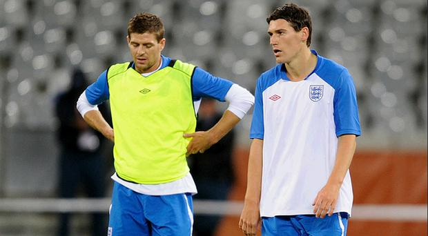 Steven Gerrard and Gareth Barry look on during the England training session at the Green Point Stadium on June 17, 2010 in Cape Town, South Africa