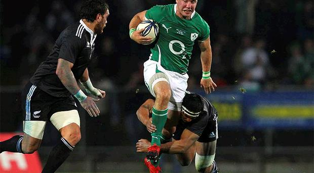 Ireland centre Paddy Wallace breaks a tackle