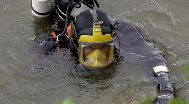 Divers were searching for a man who went into a river in Belfast