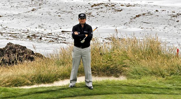 Graeme McDowell of Northern Ireland waits to putt on the seventh hole during the second round of the US Open golf tournament Friday, June 18, 2010