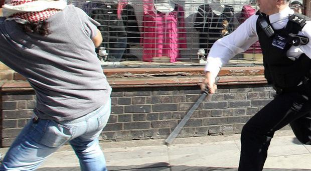 Police clash with anti-English Defence League protesters outside the East London Mosque in Whitechapel, London