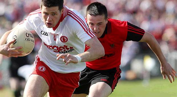 Tyrone's Sean Cavanagh drives forward during Saturday's clash