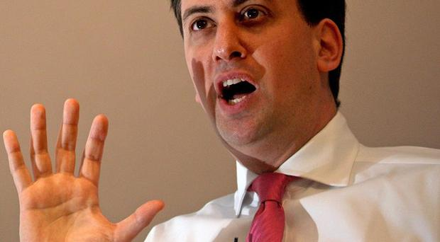 Ed Miliband has urged Lib Dems to vote against George Osborne's Budget