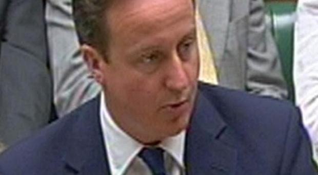 David Cameron has paid tribute to a Royal Marine who has died as a result of injuries received in Afghanistan