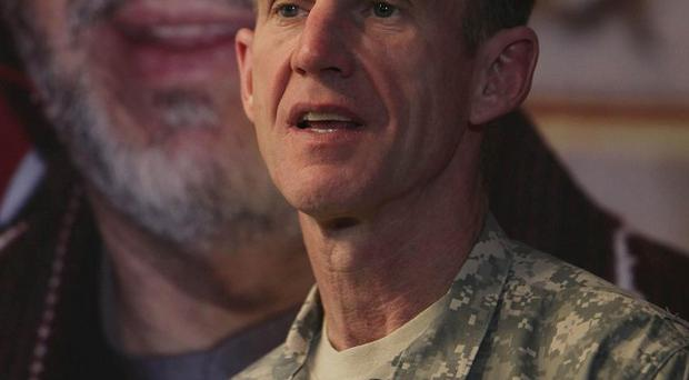 US Gen Stanley McChrystal apologises for profile in which he accused ambassador of betrayal