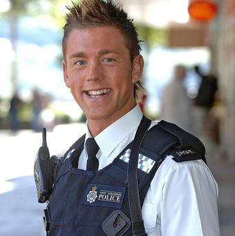 Former Mr Gay UK Pc Mark Carter has faced court accused of rape