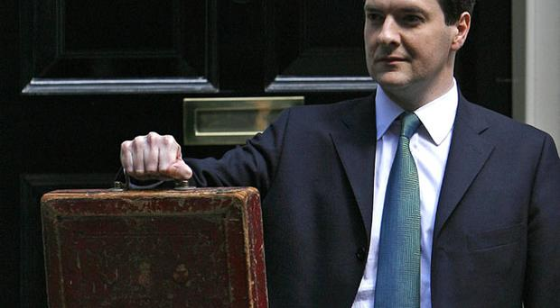 Britain's Chancellor of the Exchequer George Osborne displays his budget Box outside his official residence at 11 Downing Street in central London, Tuesday, June 22, 2010 before reading the budget statement within to Parliament