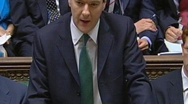 Chancellor of the Exchequer George Osborne delivers his emergency budget in the House of Commons