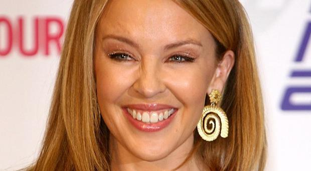 Kylie Minogue says her sister's pregnancy has made her think