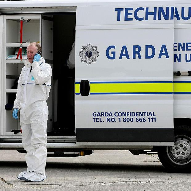 Garda probe the discovery of a woman's body in a car boot in Co Dublin