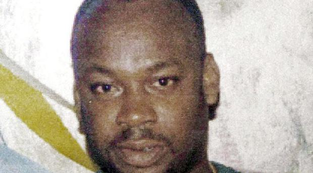 Reputed gang leader Christopher 'Dudus' Coke has reportedly surrendered to authorities in Jamaica (AP)