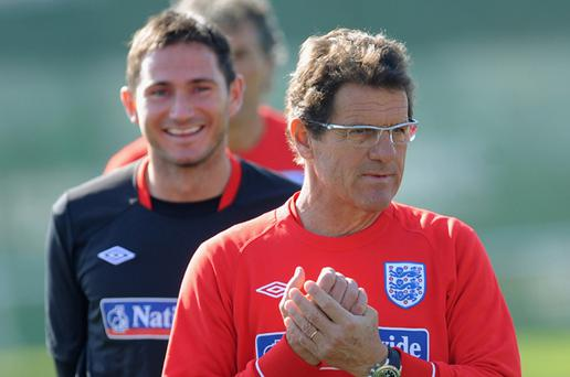 Frank Lampard smiles as England manager Fabio Capello looks on during the England training session at the Royal Bafokeng Sports Campus on