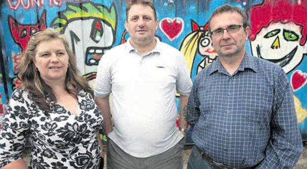 Community workers Evelyn Bronson, Billy Thompson and Tom Brown outside Dunmurry Community Association