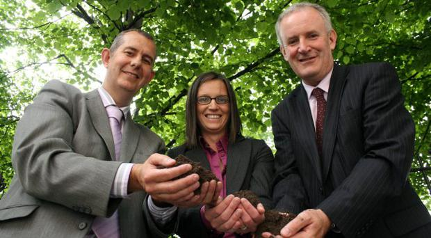 Environment minister Edwin Poots (left) samples the soil with the help of Nicola Connery, Northern Ireland Environment Agency, and John Armstrong, head of the Construction Employers Federation