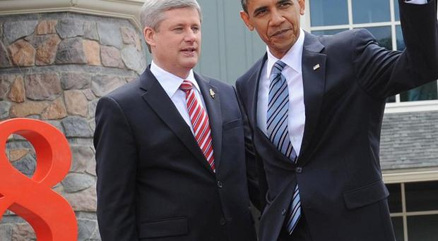 Canadian Prime minister Stephen Harper, left, welcomes President Obama to the G8 summit in Muskoka, Canada.