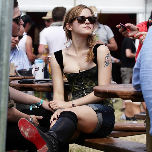 Harry Potter star Emma Watson enjoys the sun backstage during the Glastonbury Festival