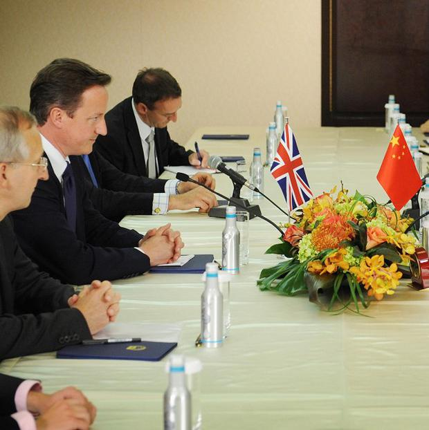 Prime Minister David Cameron meets with Chinese President Hu Jintao