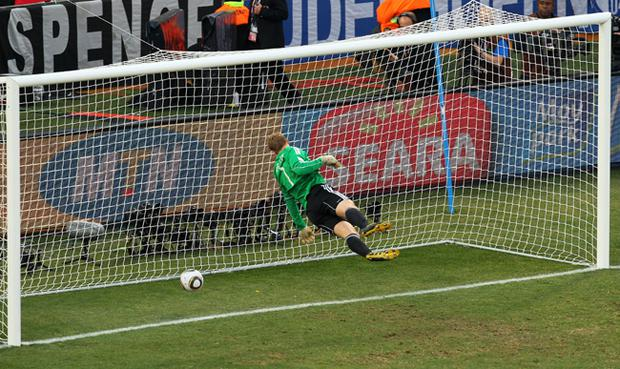Manuel Neuer of Germany watches the ball bounce over the line from a shot that hit the crossbar from Frank Lampard of England, but referee Jorge Larrionda judges the ball did not cross the line during the 2010 FIFA World Cup South Africa Round of Sixteen match between Germany and England at Free State Stadium on June 27, 2010 in Bloemfontein, South Africa