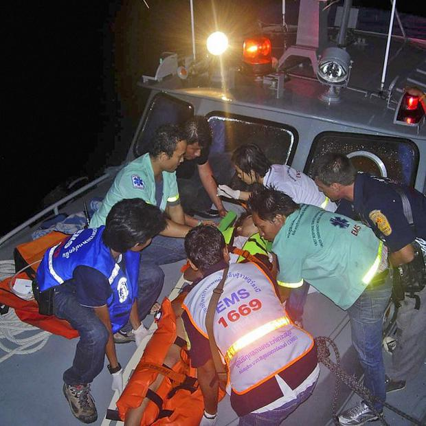 Thai rescue workers attend to an injured tourist (AP)