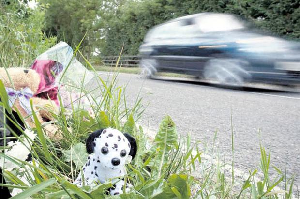 Flowers and toys mark the spot where a child died after being struck by a vehicle in Clough, Co Down