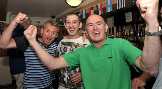 Football fans who watched the England - Germany match in The Orient Bar on the Springfield Road. Pictured from left are, Gerard McKeown, Jim McCartney and Johnny McCartney.