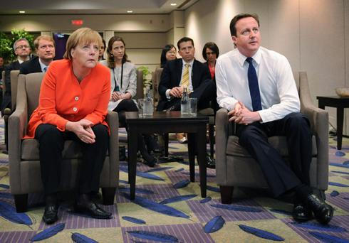 Prime Minister David Cameron watches the England versus Germany World Cup match with German Chancellor Angela Merkel at the G20 summit in Toronto, Canada