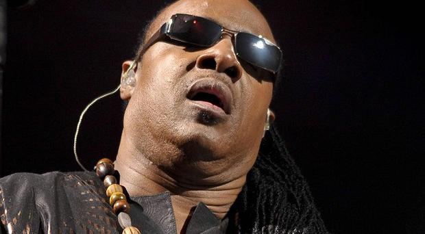 Stevie Wonder performs on the pyramid stage as he closes Glastonbury Festival 2010